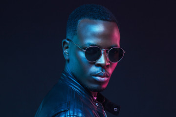 African male model portrait, wearing trendy sunglasses and leather jacket