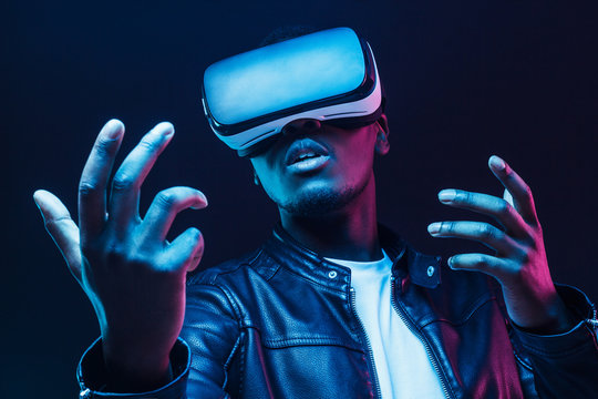 African man wearing virtual reality headset