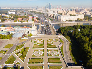 panorama high-rise buildings and transport of metropolis, Frunzenskaya Embankment and the Third Transport Ring, cars on multi-lane highways and road junction in Moscow.