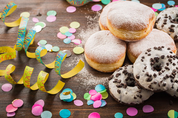 Krapfen, Berliner or  donuts with streamers and confetti