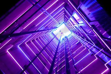 Colorful illumination in a glass elevator