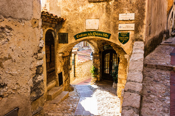 Narrow alley and old stone houses in Eze village in France.