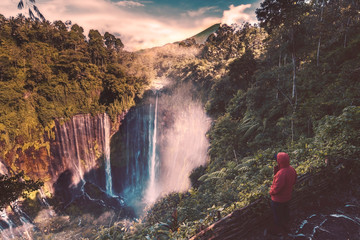 Tourist enjoying Tumpak sewu waterfall view