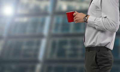 Businessman have a break with coffee cup isolated on blurred and spacious background - business concept with copy space