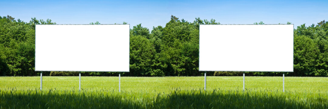 Double blank advertising billboard immersed in a rural scene - image with copy space