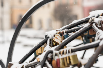 Love locks covered by snow during Valentine's day.