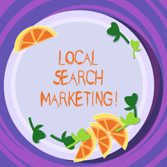 Conceptual hand writing showing Local Search Marketing. Business photo text Physical business Facetoface contact with customers Cutouts of Sliced Lime Wedge and Herb Leaves on Color Plate
