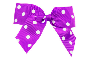 purple bow in white polka dots of turnip ribbon on white isolated background