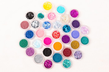little colored jars of glitter and sparkles for wearable Tatuaje