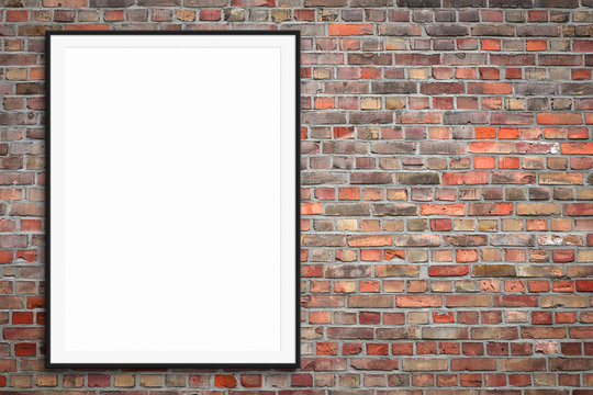 blank picture frame or framed poster mock-up on brick wall