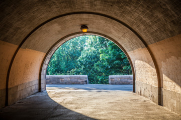 View of underpass in Central Park in New York City during sunny summer daytime