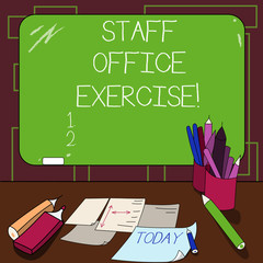 Writing note showing Staff Office Exercise. Business photo showcasing Promoting physical fitness routine for office staff Mounted Blackboard with Chalk Writing Tools Sheets on Desk