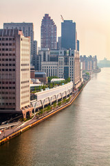Aerial view of Manhattan skyline viewed from East River during sunny summer day