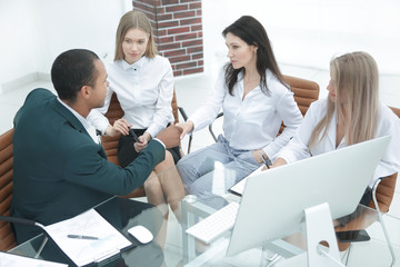 handshake of business partners in a modern office.