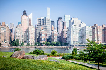 Beautiful Roosevelt Island park with Manhattan, New York City in background during sunny summer day