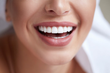 Healthy white smile close up. Beauty woman with perfect smile, lips and teeth. Beautiful Girl with...