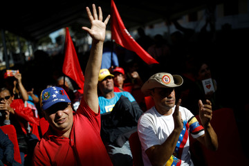 Supporters of Venezuela's President Nicolas Maduro take part in a gathering in support of his government outside the Miraflores Palace in Caracas
