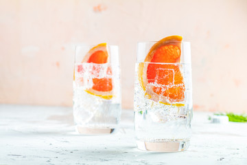 Grapefruit gin cocktail, refreshing drink with ice