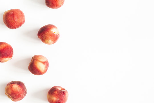 Peaches on white background. Frame made of fresh peaches. Flat lay, top view, copy space
