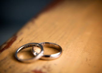 wedding bands, rings, isolated, wooden texture, table, marriage, wedding, color, horizontal image