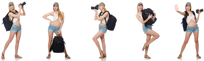 Beautiful woman in shorts with backpack and camera