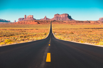 Zelfklevend Fotobehang Verenigde Staten Long road in Monument Valley at sunset, USA