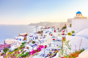 Travel Destinations. People Preparing for Sunset at Caldera Volcanic Slope of Oia Village in Santorini Island in Greece.