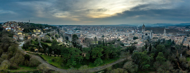 Aerial panorama view of medieval Girona with Gothic St Mary Roman Catholic cathedral, city walls and colorful houses at sunset in Girona Catalonia Spain