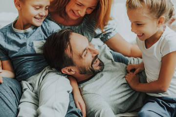 Happy parents and two kids having fun together