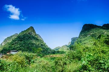 Photo sur Aluminium Bleu fonce Karst mountains scenery with blue sky background