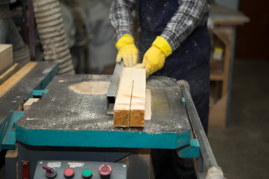 Joiner works on the machine