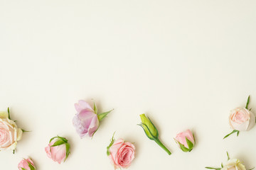 Flower composition. Assorted roses decor. Copy space on ivory background. Flat lay.