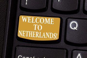 Conceptual hand writing showing Welcome To Netherlands. Business photo showcasing Warm greeting to the visitors of Netherlands Keyboard key Intention to create computer message idea
