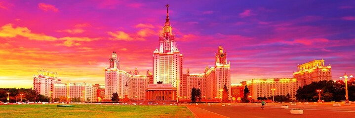 Spoed Foto op Canvas Roze Dramatic vibrant wide angle panoramic evening view of illuminated famous Russian university