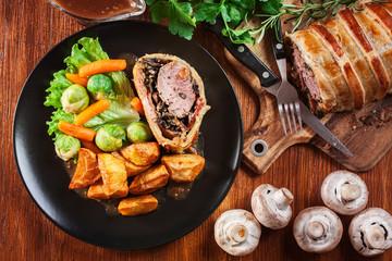 Pork tenderloin in wellington style in puff pastry