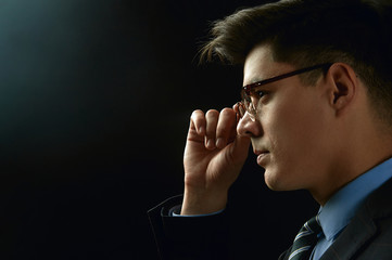 Close-up image of serious man on dark background Confident and dramatic concept
