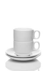 Two white cups on a white background