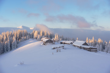 Wonderful morning in the mountainous valleys with houses in the Ukrainian Carpathians.