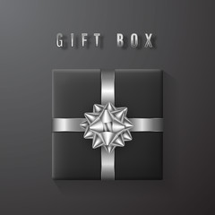 Black gift box with white, silver bow and ribbon top view. Element for decoration gifts, greetings, holidays. Vector illustration