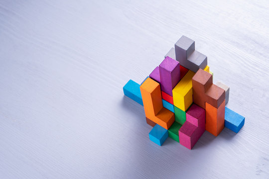 Abstract construction from wooden blocks shapes.