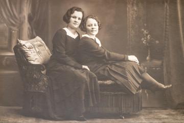 RUSSIA - CIRCA 1920s: Shot of two young women in studio, Vintage Carte de Viste Edwardian era photo