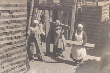 RUSSIA - CIRCA 1920s: Vintage photo of thee young women working in wine shop