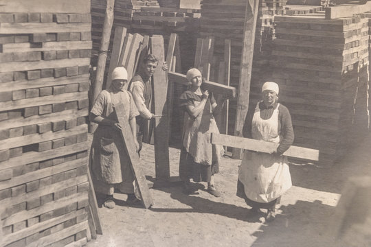RUSSIA - CIRCA 1920s: Vintage archive photo of thee young women working rail sleepers factory