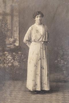 RUSSIA - CIRCA 1905-1910: Full body shot of young woman in studio, Vintage Carte de Viste Edwardian era photo