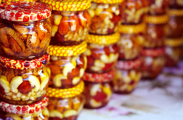 Honey with nuts in the jars