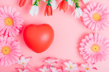 Red heart and flower on pink background
