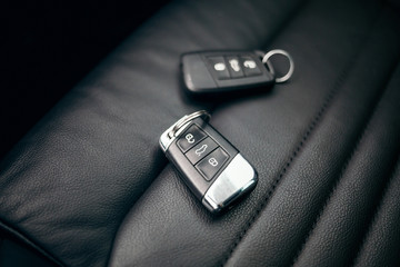 Car ignition key at leather seats