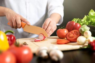Chef prepares fresh vegetables. Healthy nutrition
