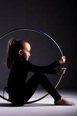 Printed kitchen splashbacks Gymnastics Teenager girl involved in rhythmic gymnastics. Black background