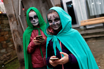 Young revelers wearing scary make up get ready for the Bocuk night, or the Thracian Halloween, in Camlica village, near the western town of Kesan